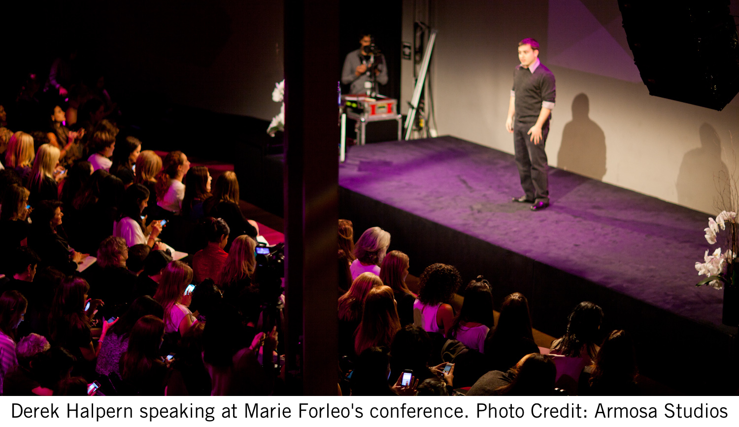 Derek Halpern speaking at Marie Forleo's conference. Photo credit: Armosa Studios.