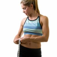 attractive blond measuring width of waist